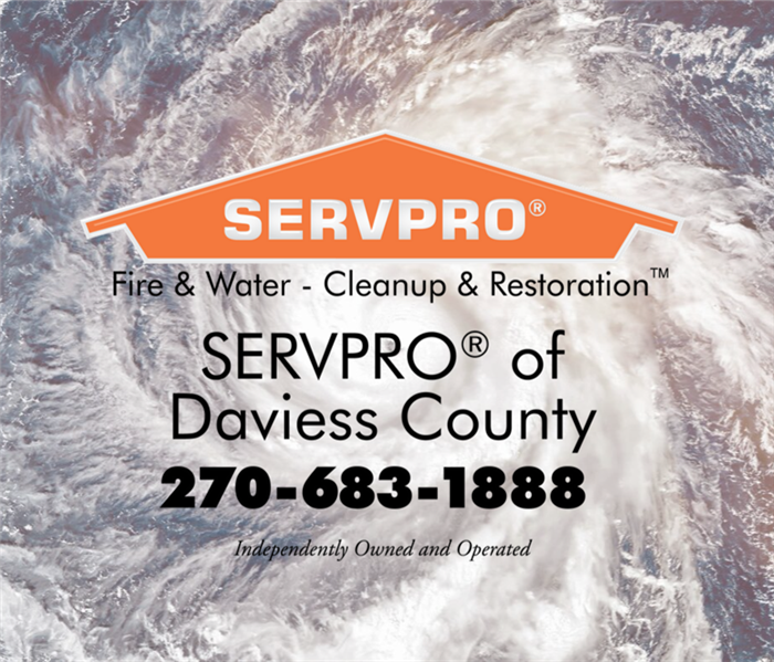 Arial view of a hurricane on the ocean with an orange SERVPRO house
