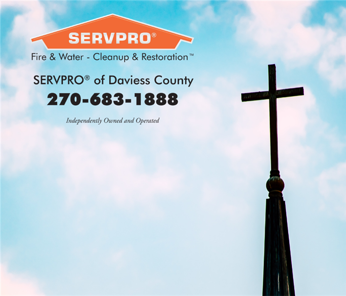 Photo of cloudy sky with a cross on the right side of photo. Orange SERVPRO logo with phone number in upper left corner