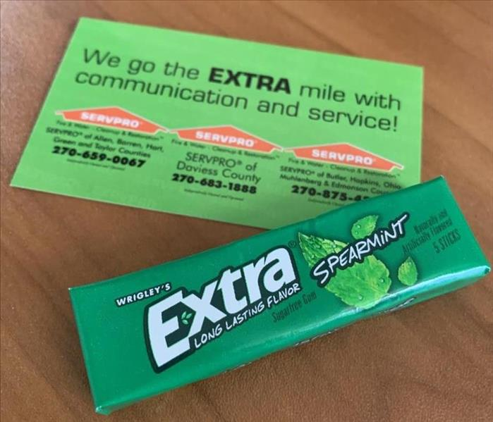 "SERVPRO card with ""We go the extra mile in communication and service!"" posed with a pack of Extra Brand gum"